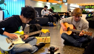 Arata and Joseph making music en route to Invercargill.
